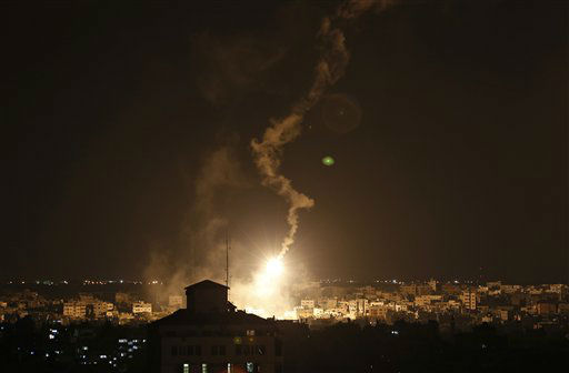 Israeli forces&#39; flares light up the sky in the northern Gaza Strip, Friday, July 18, 2014. Israeli troops pushed deeper into Gaza. <span class=meta>(AP Photo&#47; Lefteris Pitarakis)</span>