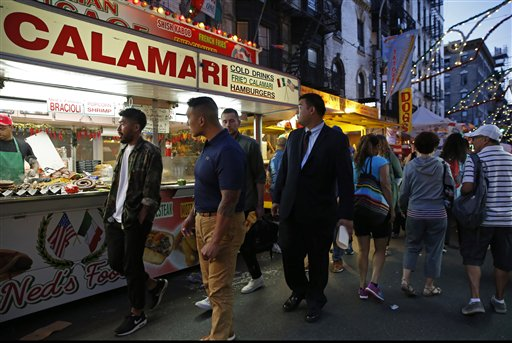 """<div class=""""meta image-caption""""><div class=""""origin-logo origin-image ap""""><span>AP</span></div><span class=""""caption-text"""">People stroll down checking out the offerings from food vendors Mulberry Street during the annual Feast of San Gennaro in New York's Little Italy neighborhood, Sept. 15, 2016 (AP)</span></div>"""