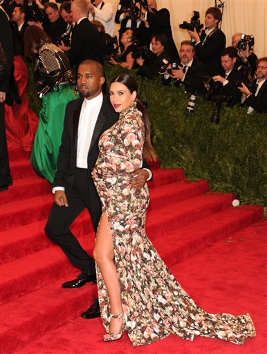 """<div class=""""meta image-caption""""><div class=""""origin-logo origin-image ap""""><span>AP</span></div><span class=""""caption-text"""">Kim Kardashian Kanye West attend The Metropolitan Museum of Art  Costume Institute gala benefit, """"Punk: Chaos to Couture"""", on Monday, May 6, 2013   (Evan Agostini/Invision/AP) (Evan Agostini/Invision/AP)</span></div>"""