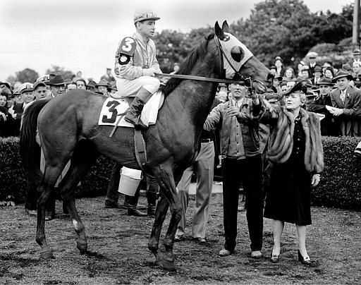 "<div class=""meta image-caption""><div class=""origin-logo origin-image none""><span>none</span></div><span class=""caption-text"">Jockey Johnny Longden is seated on Count Fleet in New York on May 22, 1943. Longden rode Count Fleet to thoroughbred racing's Triple Crown. (AP Photo) (AP Photo/ MEE DB RWP JMB PF PC)</span></div>"