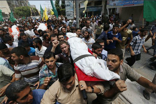 Palestinian mourners carry the bodies of four members of the al-Astal family, who were killed Wednesday by an Israeli airstrike. <span class=meta>(AP Photo&#47; Lefteris Pitarakis)</span>