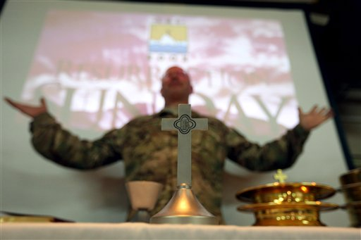 <div class='meta'><div class='origin-logo' data-origin='none'></div><span class='caption-text' data-credit='AP'>Military and civil service members of the NATO support mission hold an Easter service at their headquarters in Kabul, Afghanistan, Sunday, March 27, 2016. (AP Photo/Rahmat Gul)</span></div>