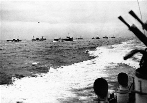 "<div class=""meta image-caption""><div class=""origin-logo origin-image none""><span>none</span></div><span class=""caption-text"">Landing craft, escorted by ships of the Royal Navy, sail to the Great Assault on June 5, 1944 the guns of H.M. ship are at the ready.  (AP Photo/ IP PM, NC. KEY R3, D.  XJFM)</span></div>"