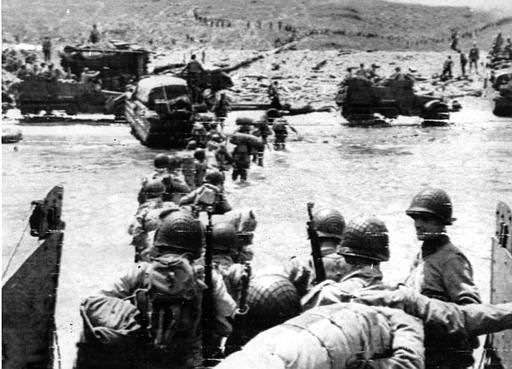 "<div class=""meta image-caption""><div class=""origin-logo origin-image none""><span>none</span></div><span class=""caption-text"">Ducks (amphibious trucks) and a half-track follow foot troops ashore during the invasion of Normandy on a 100-mile front along the French coast by allied forces on June 6, 1944.   (AP Photo/ XCJ AD)</span></div>"
