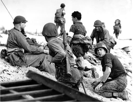 <div class='meta'><div class='origin-logo' data-origin='none'></div><span class='caption-text' data-credit='AP Photo/ XCJ AD'>A first wave beach battalion Ducks lays low under the fire of Nazi guns on the beach of southern France on D-Day, June 6, 1944 during World War II.</span></div>