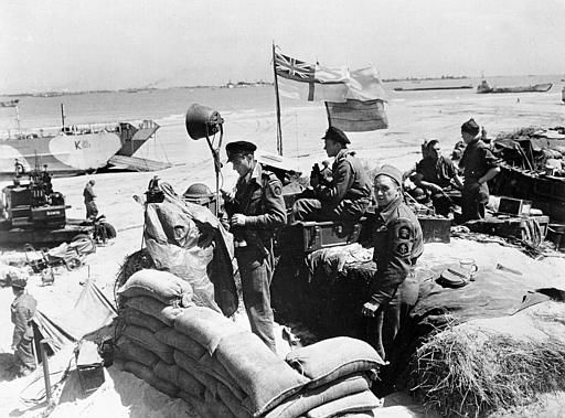 <div class='meta'><div class='origin-logo' data-origin='none'></div><span class='caption-text' data-credit='AP Photo/ XNBG'>British troops make their way through low water and up the beach after leaving landing craft which transported them across the Channel to the Normandy beachhead.</span></div>