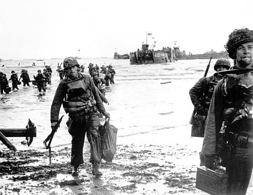 <div class='meta'><div class='origin-logo' data-origin='none'></div><span class='caption-text' data-credit='AP Photo/ XCB'>Carrying full equipment, American assault troops move onto a beachhead code-named Omaha Beach, on the northern coast of France on June 6, 1944.</span></div>