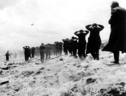 <div class='meta'><div class='origin-logo' data-origin='none'></div><span class='caption-text' data-credit='AP Photo/ XCB'>German prisoners of war are led away by Allied forces from Utah Beach, on June 6, 1944, during landing operations at the Normandy coast, France.</span></div>