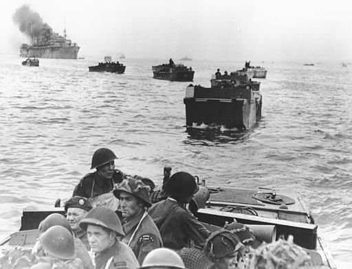 "<div class=""meta image-caption""><div class=""origin-logo origin-image none""><span>none</span></div><span class=""caption-text"">Canadian troops in landing crafts approach a stretch of coastline code-named Juno Beach, near Bernieres-sur-mer, as the Allied Normandy invasion gets under way, on June 6, 1944.  (AP Photo/ XCB)</span></div>"