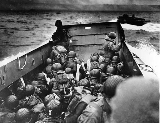 "<div class=""meta image-caption""><div class=""origin-logo origin-image none""><span>none</span></div><span class=""caption-text"">A U.S. Coast Guard landing barge, tightly packed with helmeted soldiers, approaches the shore at Normandy, France, during initial Allied landing operations, June 6, 1944.  (AP Photo/ ANONYMOUS)</span></div>"