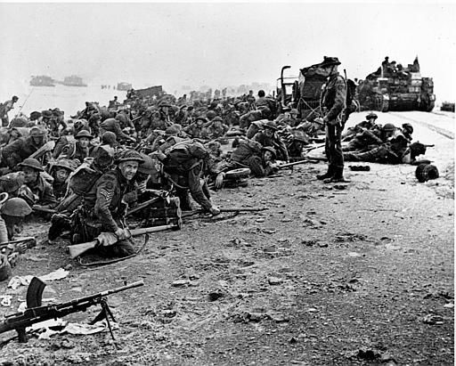 <div class='meta'><div class='origin-logo' data-origin='none'></div><span class='caption-text' data-credit='AP Photo/ XCB'>After landing at the shore, these British troops wait for the signal to move forward, during the initial Allied landing operations in Normandy, France, June 6, 1944.</span></div>