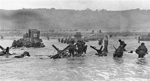 "<div class=""meta image-caption""><div class=""origin-logo origin-image none""><span>none</span></div><span class=""caption-text"">Some of the first assault troops to hit the Normandy, France beachhead take cover behind enemy obstacles to fire on German forces. (AP Photo/ IP NC,GP. KEY R3, RE. XMH PDS **)</span></div>"