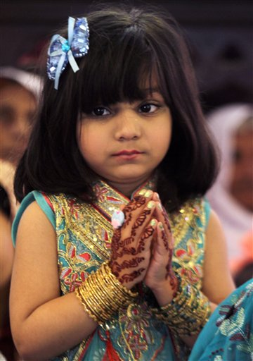 <div class='meta'><div class='origin-logo' data-origin='none'></div><span class='caption-text' data-credit='AP'>A Christian girl prays during an Easter service at St Anthony's Church in Lahore, Pakistan,  (AP Photo/K.M. Chaudary)</span></div>