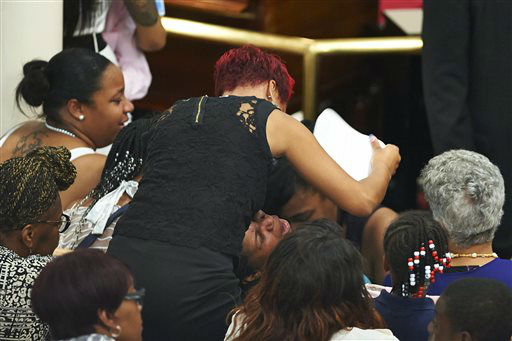 Esaw Garner, center, cries during a funeral for her husband, Eric Garner, at Bethel Baptist Church. <span class=meta>(AP Photo&#47; James Keivom)</span>