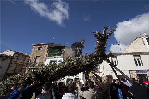 <div class='meta'><div class='origin-logo' data-origin='none'></div><span class='caption-text' data-credit='AP'>A cross is erected in the village square in Tielmes, Spain (AP Photo/Paul White)</span></div>