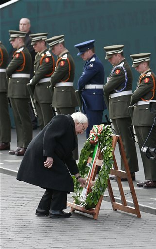 <div class='meta'><div class='origin-logo' data-origin='none'></div><span class='caption-text' data-credit='AP'>Irish President Michael D Higgins lays a wreath at the General Post Office on O'Connell street, Dublin, Ireland. (AP Photo/Peter Morrison)</span></div>