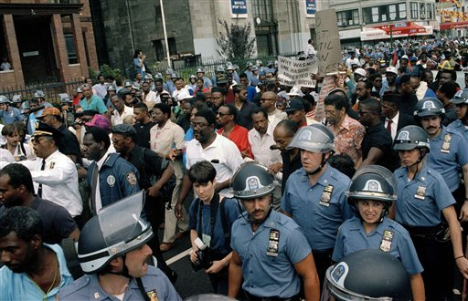"<div class=""meta image-caption""><div class=""origin-logo origin-image none""><span>none</span></div><span class=""caption-text"">Hundreds of protesters, escorted by police, march towards Lubovitcher Synagogue in the Crown Heights section of Brooklyn, New York, Aug. 24, 1991. (AP Photo/Joe Major)</span></div>"