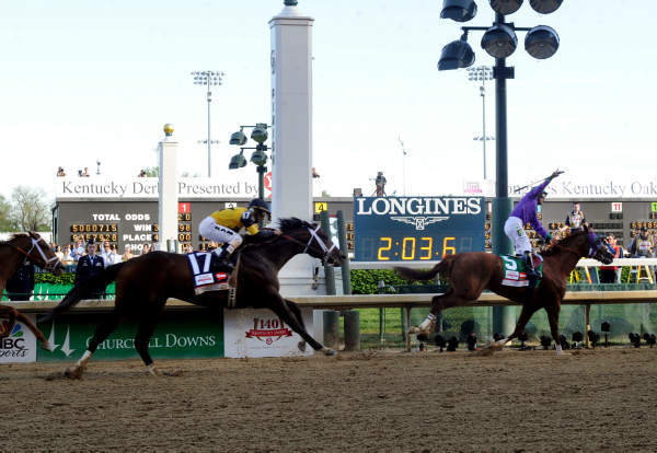 California Chrome, ridden by jockey Victor Espinoza, celebrates as he wins the 140th Kentucky Derby, Saturday, May 3, 2014. <span class=meta>(Photo&#47;Diane Bondareff)</span>