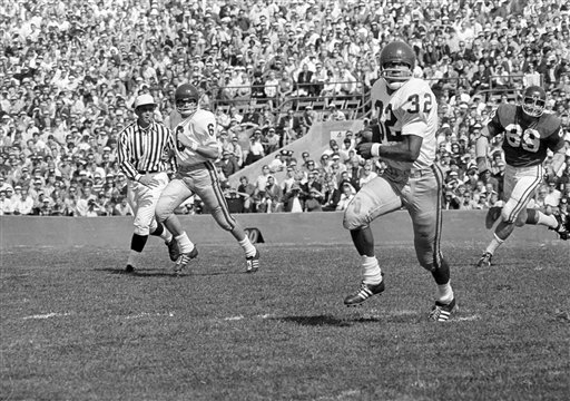 <div class='meta'><div class='origin-logo' data-origin='none'></div><span class='caption-text' data-credit='AP Photo'>USC's O.J. Simpson (32) is pictured in action against Northwestern at Evanston, Ill., Sept. 28, 1968.</span></div>