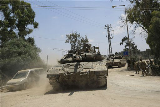 Israeli tanks ride along the border of Israel and the Gaza Strip, Sunday, July 20, 2014.  <span class=meta>(AP Photo&#47; Tsafrir Abayov)</span>