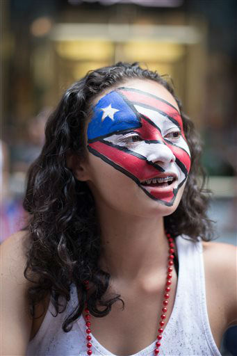<div class='meta'><div class='origin-logo' data-origin='none'></div><span class='caption-text' data-credit=''>Hundreds of thousands of people packed New York's Fifth Avenue Sunday for the Puerto Rican Day parade. (AP Photo)</span></div>