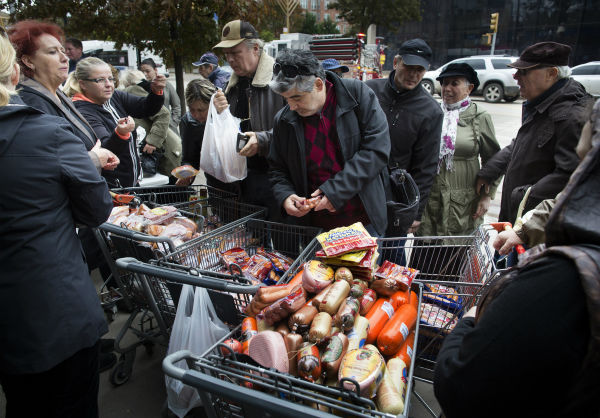 <div class='meta'><div class='origin-logo' data-origin='none'></div><span class='caption-text' data-credit='AP Photo/ John Minchillo'>A customer browses food piled into shopping carts on Brighton Beach Avenue, Wednesday, Oct. 31, 2012, in the Brooklyn borough.</span></div>