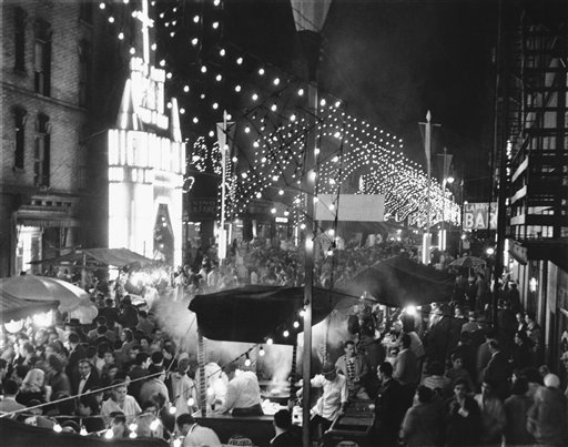 """<div class=""""meta image-caption""""><div class=""""origin-logo origin-image ap""""><span>AP</span></div><span class=""""caption-text"""">All the color and gaiety, pomp and solemnity of an old Italian religious festival, or festa, came to the drab, narrow streets of New York's lower East Side, Sept. 24, 1956. (AP)</span></div>"""