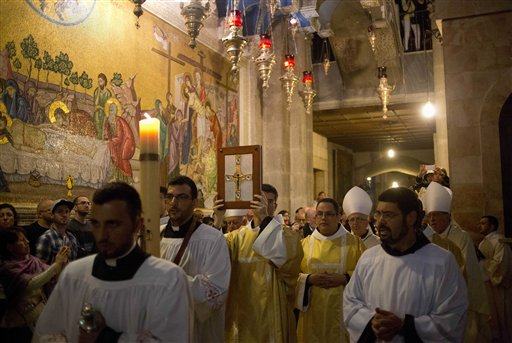 <div class='meta'><div class='origin-logo' data-origin='none'></div><span class='caption-text' data-credit='AP'>Christian clergymen participate in the Easter Sunday procession at the Church of the Holy Sepulchre, in Jerusalem's Old City, Israel. (AP Photo/Ariel Schalit)</span></div>