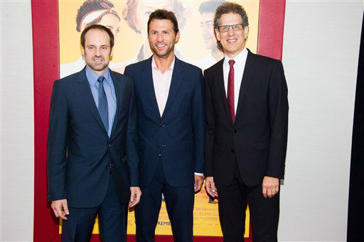 "Jeffrey Skoll, left, Jonathan King and Jim Berk attend ""The Hundred-Foot Journey"" premiere on Monday, August 4, 2014 in New York. (Photo by Charles Sykes/Invision/AP)"