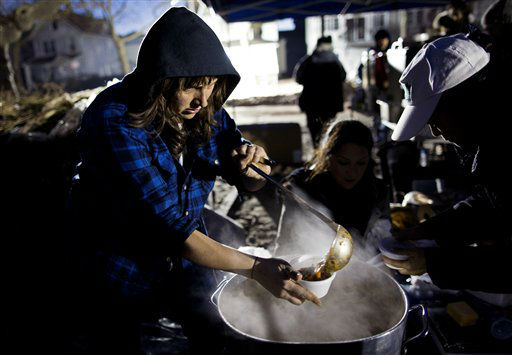 <div class='meta'><div class='origin-logo' data-origin='none'></div><span class='caption-text' data-credit='AP Photo/ Craig Ruttle'>Ariel Nadelberg of Brooklyn pours hot soup at a parking lot that became a makeshift place where those in need could get food and clothing in Rockaway.</span></div>