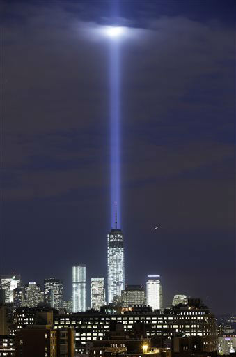 "<div class=""meta image-caption""><div class=""origin-logo origin-image none""><span>none</span></div><span class=""caption-text"">A test of the twin beams of the Tribute in Light intersect with still-under construction One World Trade as they rise above lower Manhattan, Monday, Sept. 9, 2013. (AP Photo/ Kathy Willens)</span></div>"