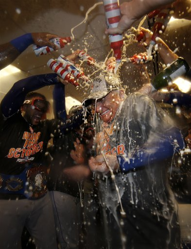 """<div class=""""meta image-caption""""><div class=""""origin-logo origin-image ap""""><span>AP</span></div><span class=""""caption-text"""">New York Mets manager Terry Colllins is doused with champagne and beer in the clubhouse. (AP)</span></div>"""