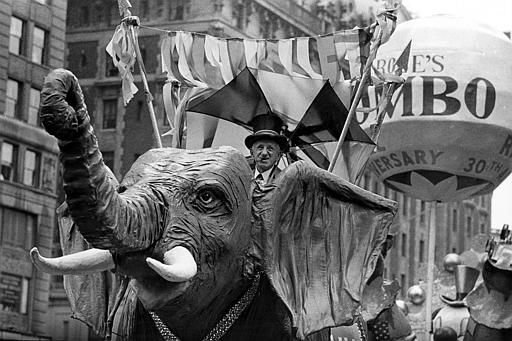 <div class='meta'><div class='origin-logo' data-origin='none'></div><span class='caption-text' data-credit=''>Comedian Jimmy Durante rides on a Jumbo the elephant float during the annual Macy's Thanksgiving Day Parade in New York City on Nov. 22, 1962.</span></div>