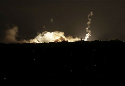 Israeli forces&#39; flares light up the night sky next to smoke caused by flares in the northern Gaza Strip, early Saturday, July 19, 2014.  &#40;AP Photo&#47;Adel Hana&#41; <span class=meta>(AP Photo&#47; Adel Hana)</span>