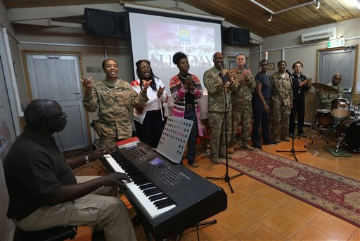 <div class='meta'><div class='origin-logo' data-origin='none'></div><span class='caption-text' data-credit='AP'>Military and civil service members of the NATO support mission sing a hymn during an Easter service at their headquarters in Kabul, Afghanistan. (AP Photo/Rahmat Gul)</span></div>