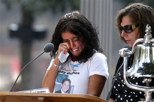 """<div class=""""meta image-caption""""><div class=""""origin-logo origin-image none""""><span>none</span></div><span class=""""caption-text"""">A woman wipes her eyes after reading the name of her brother, Bobby Hughes, at the National September 11 Memorial in 2013. (AP Photo/ Jason DeCrow)</span></div>"""