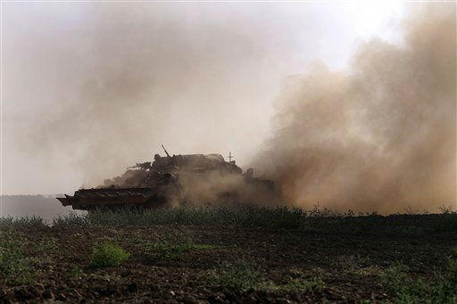 An Israeli tank rides along the border of Israel and the Gaza Strip, Sunday, July 20, 2014.  <span class=meta>(AP Photo&#47; Tsafrir Abayov)</span>
