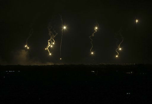 Israeli forces&#39; flares light up the night sky in the northern Gaza Strip, early Saturday, July 19, 2014. <span class=meta>(AP Photo&#47; Adel Hana)</span>