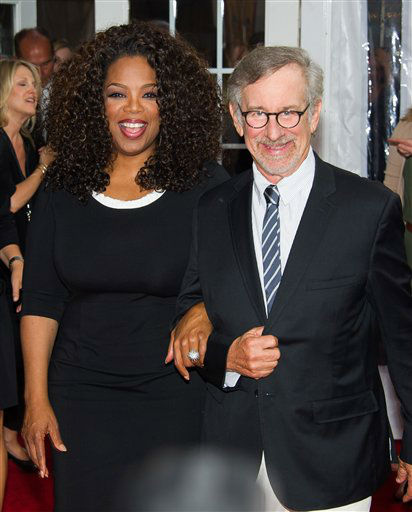 "Producers Oprah Winfrey and Steven Spielberg attend ""The Hundred-Foot Journey"" premiere on Monday, August 4, 2014 in New York. (Photo by Charles Sykes/Invision/AP)"