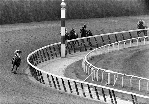 "<div class=""meta image-caption""><div class=""origin-logo origin-image none""><span>none</span></div><span class=""caption-text"">Ron Turcotte, aboard Secretariat, looks at the field as they make the final turn on the way to winning the Belmont by 31 lengths, and the 1973 Triple Crown. (AP Photo/Dave Pickoff) (AP Photo/ DAVE PICKOFF)</span></div>"