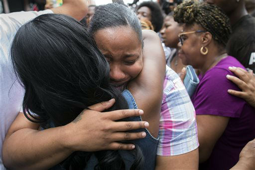 Emerald Garner, daughter of Eric Garner, mourns at the site of her father&#39;s death. <span class=meta>(AP Photo&#47; John Minchillo)</span>