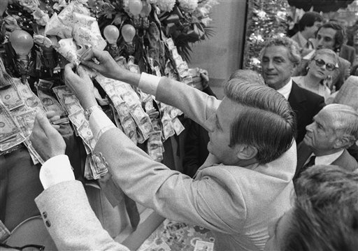 """<div class=""""meta image-caption""""><div class=""""origin-logo origin-image ap""""><span>AP</span></div><span class=""""caption-text"""">Democratic vice presidential candidate Walter Mondale pins money on the base of the statue of San Gennaro, Sunday, Sept. 19, 1976 (Associated Press)</span></div>"""