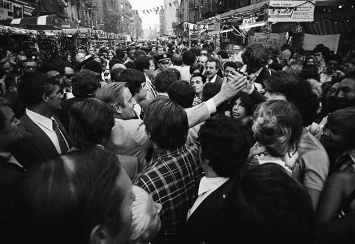"""<div class=""""meta image-caption""""><div class=""""origin-logo origin-image ap""""><span>AP</span></div><span class=""""caption-text"""">Sen. Walter Mondale, democratic vice presidential candidate, reaches cut to shake hands as he is engulfed in crowd at the San Gennaro festival in Little Italy Sept. 19, 1976. (Associated Press)</span></div>"""