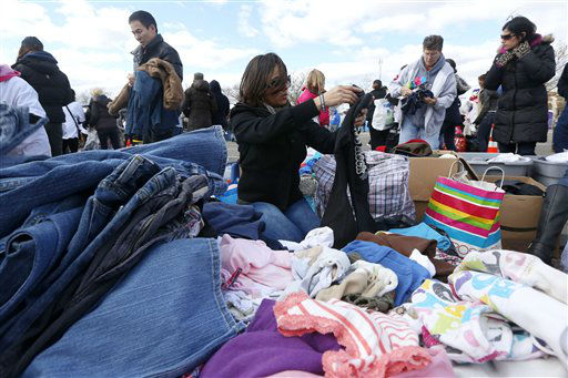 <div class='meta'><div class='origin-logo' data-origin='none'></div><span class='caption-text' data-credit='AP Photo/ Julio Cortez'>Maria Heidelberg, center, sorts through donated clothing to be sent out to a neighborhood hit by Superstorm Sandy, Saturday, Nov. 3, 2012, in Staten Island.</span></div>