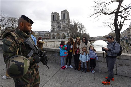 <div class='meta'><div class='origin-logo' data-origin='none'></div><span class='caption-text' data-credit='AP'>French soldier patrols as worshipers and tourists arrive for the Easter mass at Notre Dame Cathedral, in Paris, France, Sunday, March 27, 2016. (AP Photo/Francois Mori)</span></div>