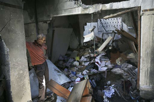 Omar al-Far stands in his bedroom after his home was hit by an overnight Israeli missile strike in Jabaliya refugee camp. <span class=meta>(AP Photo&#47; Adel Hana)</span>