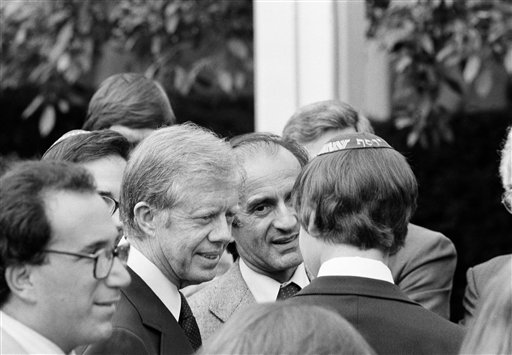 <div class='meta'><div class='origin-logo' data-origin='AP'></div><span class='caption-text' data-credit='(AP Photo/Charles Tasnadi)'>President Jimmy Carter, left, and Elie Weisel stop to chat with a young spectator on the South Lawn of the White House on Sept. 27, 1979.</span></div>