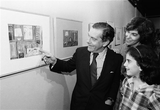 <div class='meta'><div class='origin-logo' data-origin='AP'></div><span class='caption-text' data-credit='AP Photo/ Richard Drew'>Television newsman Morley Safer points to one of his watercolors as wife Jane and daughter Sarah look on, on Monday, Sept. 22, 1980.</span></div>