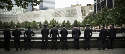 "<div class=""meta image-caption""><div class=""origin-logo origin-image none""><span>none</span></div><span class=""caption-text"">Members of the Fire Department of New York take time to reflect during memorial observances on the 13th anniversary of the Sept. 11 terror attacks. (AP Photo/ Andrew Burton)</span></div>"