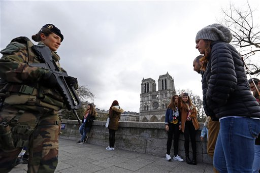 <div class='meta'><div class='origin-logo' data-origin='none'></div><span class='caption-text' data-credit='AP'>French forces soldier patrols as worshipers and tourists arrive for the Easter mass at Notre Dame Cathedral, in Paris, France, Sunday, March 27, 2016. (AP Photo/Francois Mori)</span></div>